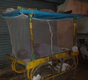 The roadside vendor shows the effective way to keep mosquitos away.